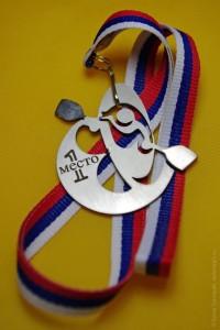 Эксклюзивная медаль за победу в соревнованиях по фристайл-каякингу на гладкой воде